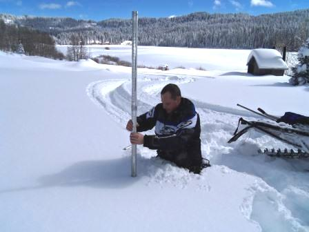 Photo showing employee taking a Snow Survey in the City of Grand Junction watershed
